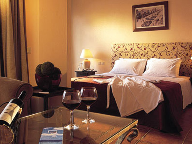 Grecotel Egnatia Grand Hotel - Deluxe Suite Living Room & Bedroom