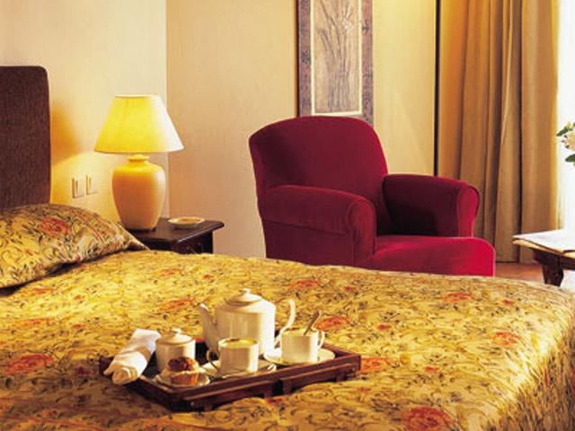 Grecotel Egnatia Grand Hotel - Guestroom Bedroom