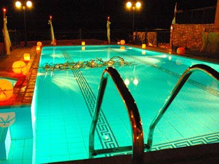 Vergis Epavlis Luxurious Suites - Swimming Pool at Night