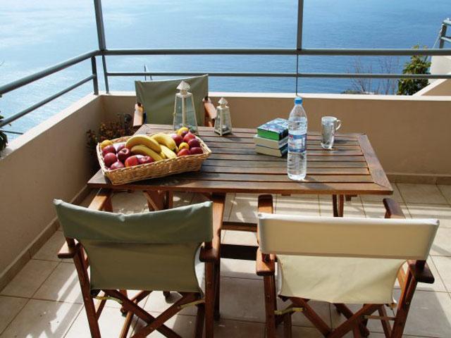 Anemos Luxury Villas - Balcony Dining Area