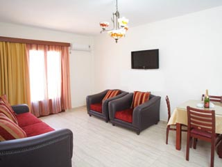 Arkasa Bay Hotel - Luxurius Apartment Living Room